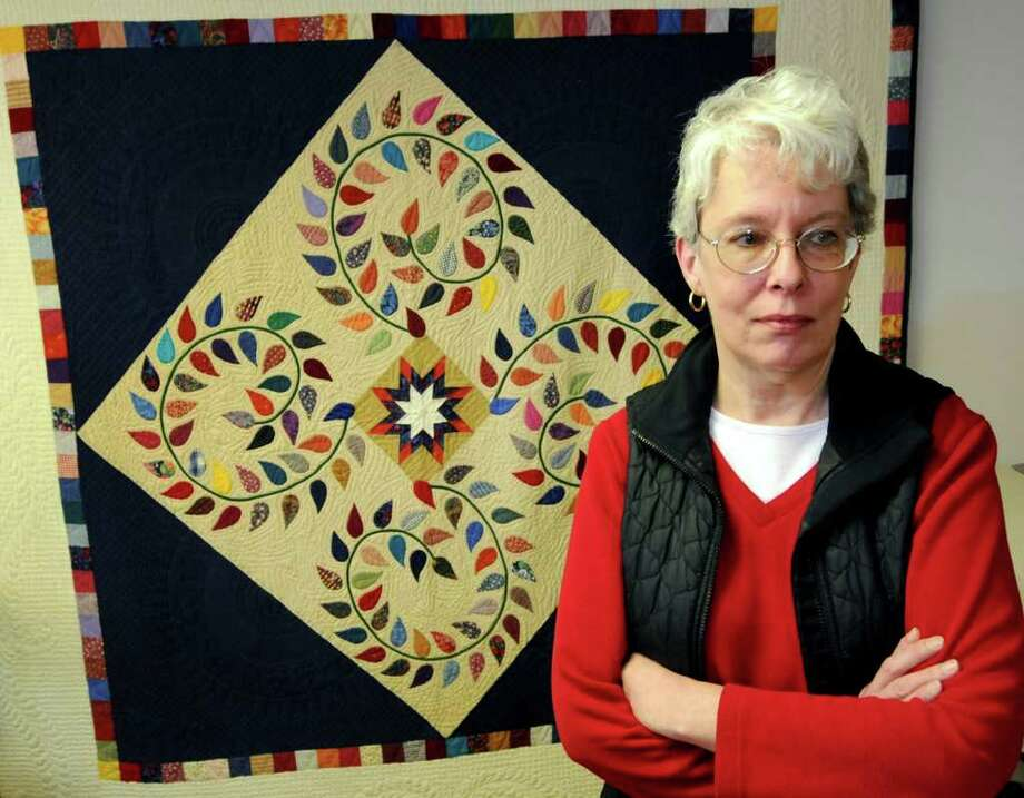 Quilter Janet Atkins of Coxsackie stands by one of her hand-sewn quilts on Wednesday, March 16, 2011, in Coxsackie, N.Y. An award-winning quilt, that was mailed through UPS, is missing(Cindy Schultz / Times Union) Photo: Cindy Schultz