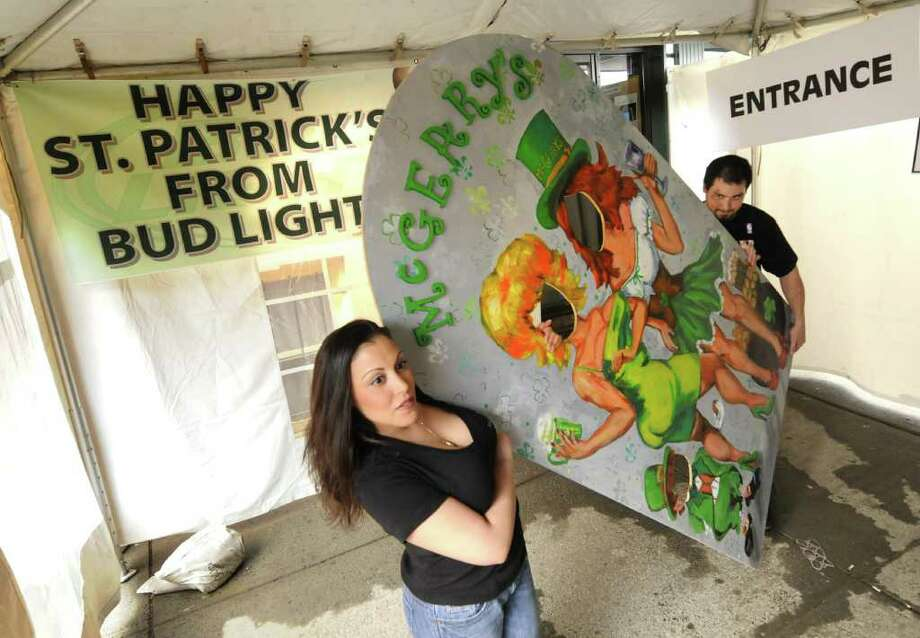McGeary's bar manager Karen M Caraher and cook Max Contompasis get a Irish themed photo cut out  ready as they decorate for Thursday's St. Patrick's day celebration at the downtown Albany establishment Wednesday March 16,2011.( Michael P. Farrell/Times Union ) Photo: Michael P. Farrell