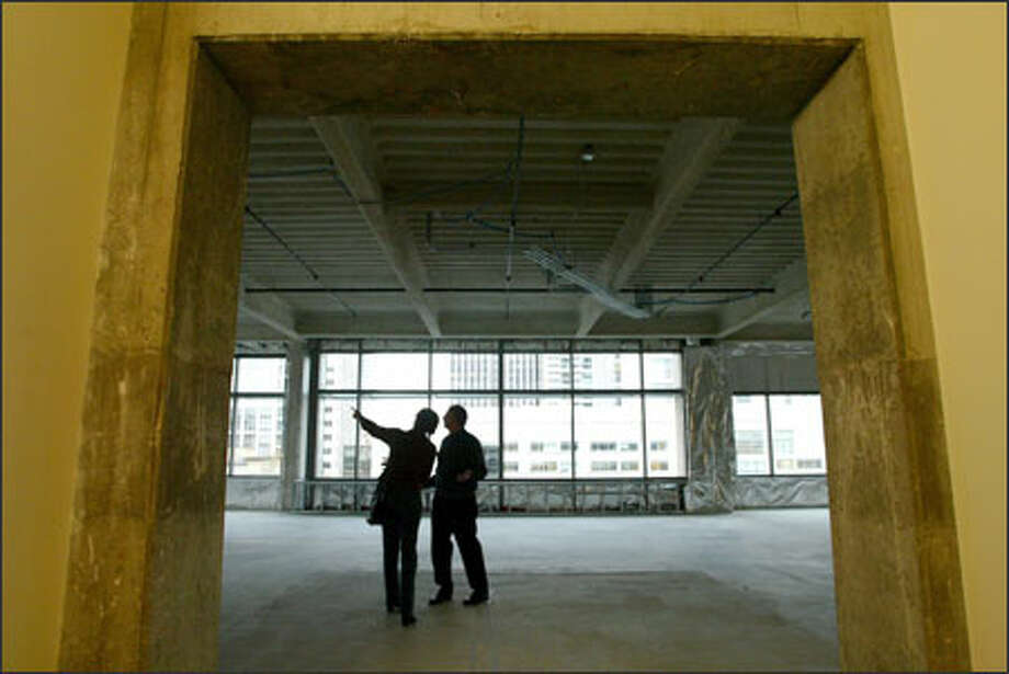 Developer Douglas Howe, right, and Lynne Barker, the city's sustainable development planner, explore a vacant floor of the 9th and Stewart Life Sciences Building. Photo: Joshua Trujillo/Seattle Post-Intelligencer / Seattle Post-Intelligencer