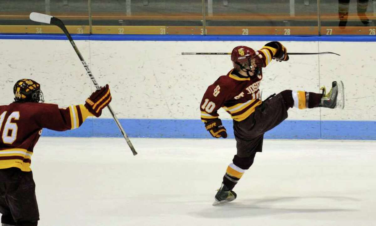 St. Joseph's #10 Conor Crouse, right, shakes his leg in the air after scoring a point against New Canaan, during CIAC Class I semifinal boys hockey action at Yale's Ingalis Rink in New Haven, Conn. on Wednesday March 16, 2011.