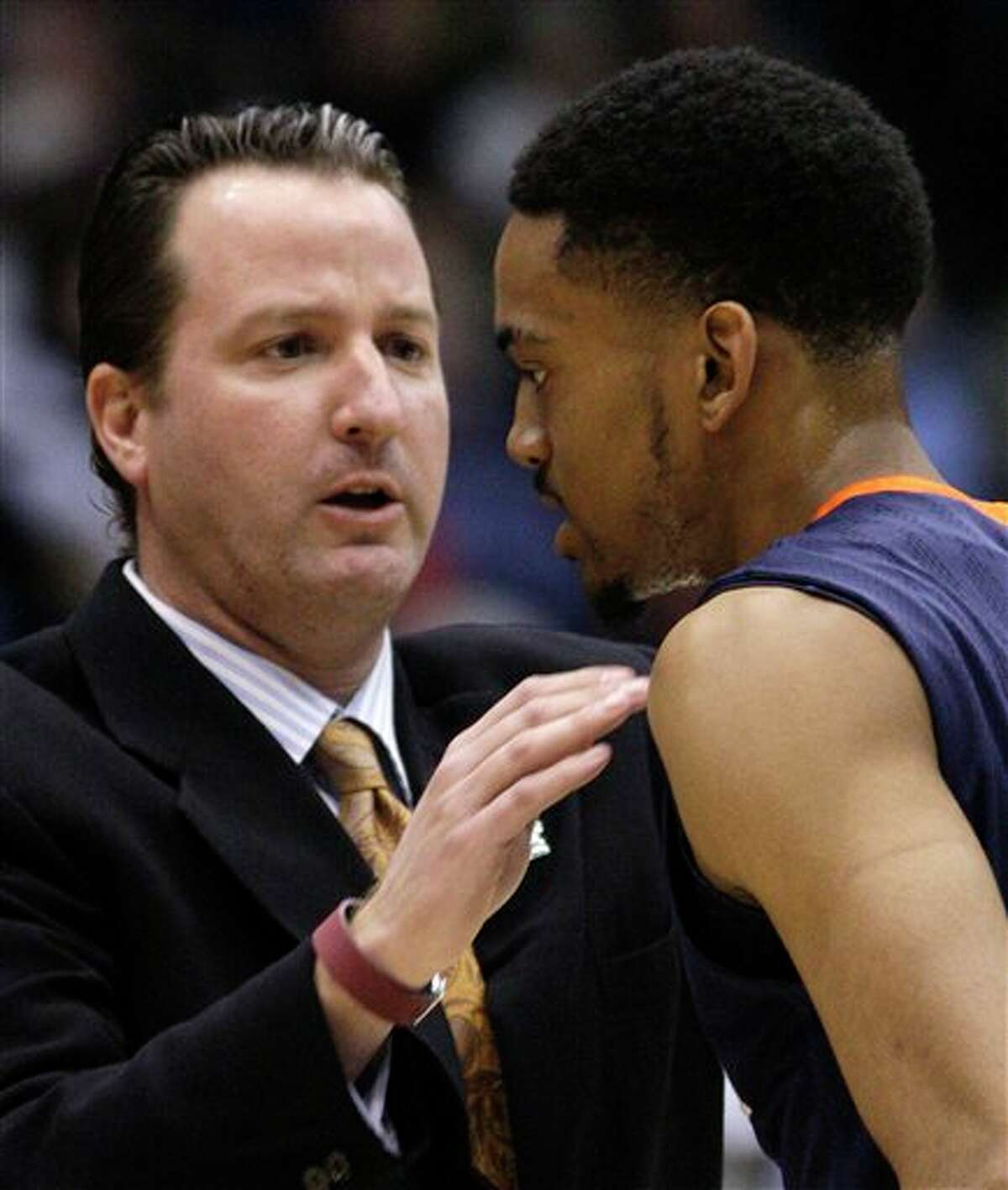 UTSA coach Brooks Thompson talks with guard Melvin Johnson III in the first half of a first-round NCAA college basketball tournament game against Alabama State, Wednesday. (AP Photo)