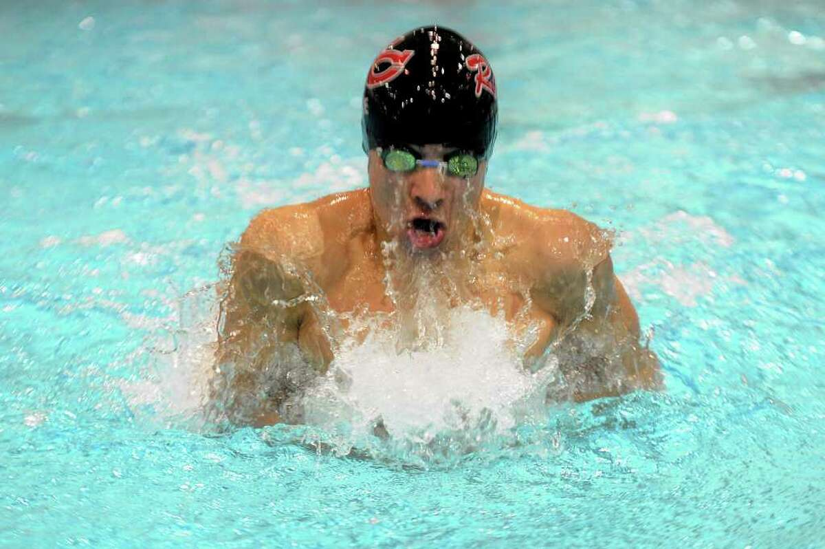A New Canaan swimmer competes in the 200-yard medley relay during Wednesday's Class M swimming championships at Wesleyan University on March 16, 2011.