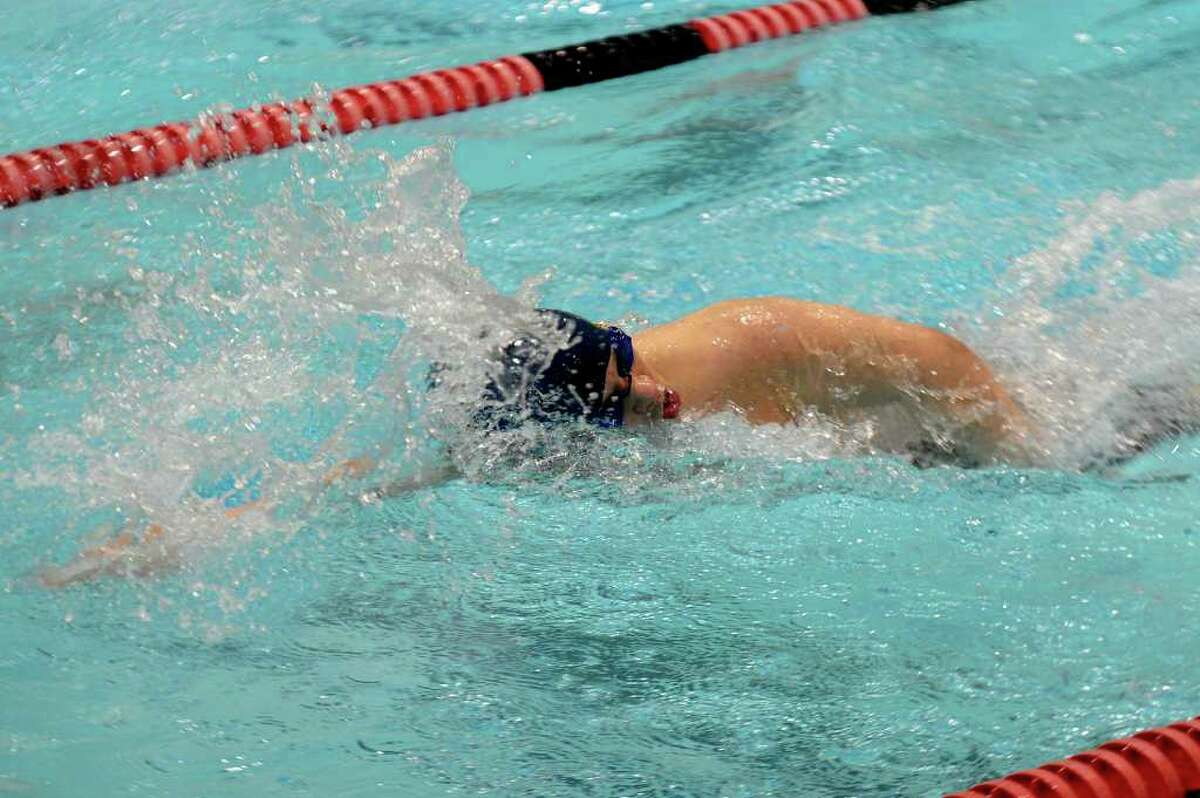 Darien's William Smelser competes in the 200-yard freestyle during Wednesday's Class M Championship meet at Wesleyan University on March 16, 2011.