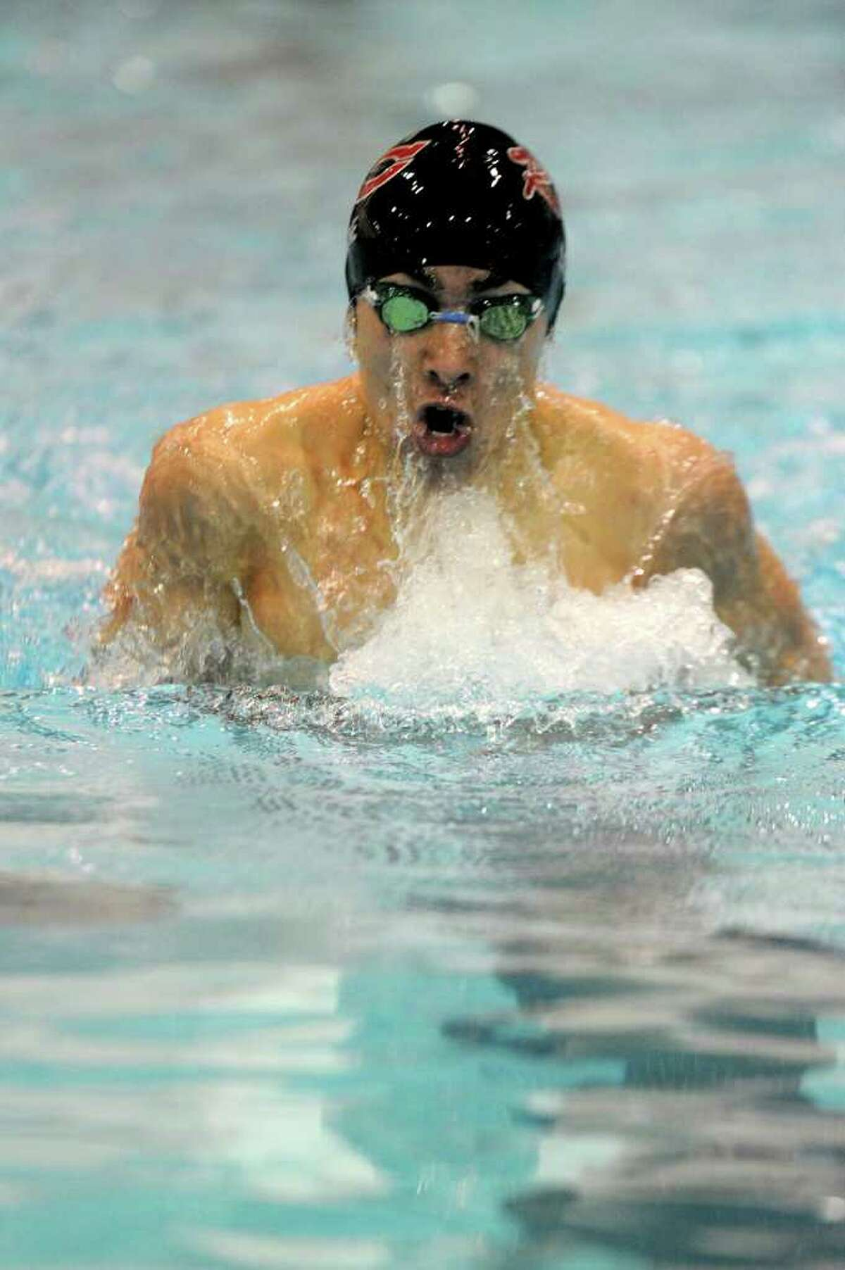 New Canaan's Gabe Lane competes in the second heat of the 200-yard individual medley during Tuesday's Class M Championship meet at Wesleyan University on March 16, 2011.
