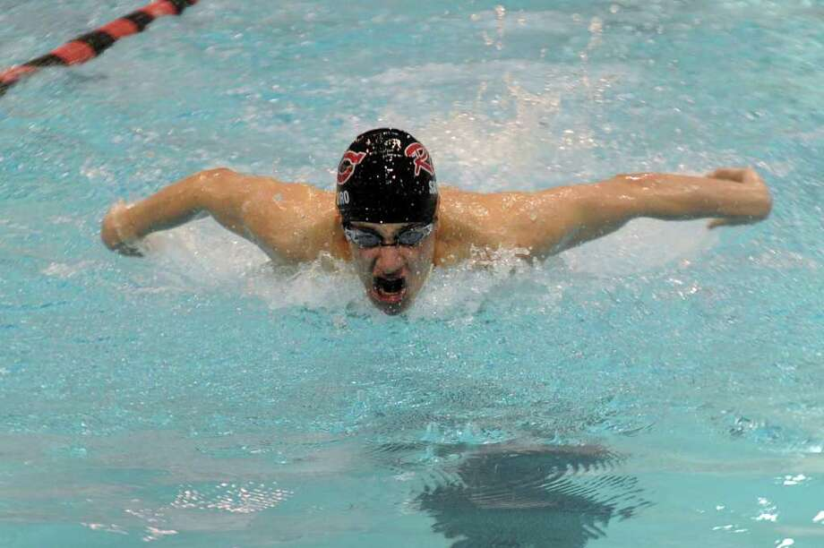 New Canaan's John Santoro competes in the third heat of the 200-yard individual medley during Tuesday's Class M Championship meet at Wesleyan University on March 16, 2011. Photo: Lindsay Niegelberg / Connecticut Post