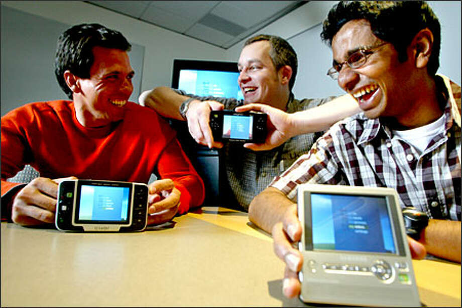 Microsoft's Portable Media Center was developed in the spare time of employees, from left, Marcus Ash, Brian King and Udiyan Padmanabhan. Photo: Karen Ducey/Seattle Post-Intelligencer