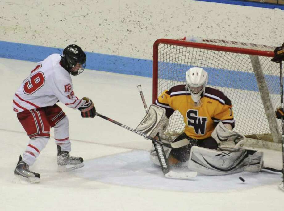Highlights from CIAC Class I semifinal boys hockey action between Fairfield Prep and South Windsor at Yale's Ingalis Rink in New Haven on Wednesday March 16, 2011. Prep's #19 David Griffin, left, attempts a goal. Photo: Christian Abraham / Connecticut Post