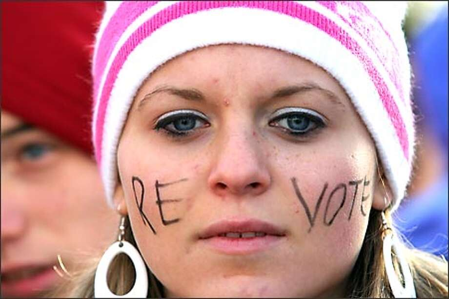 Alisha Blake, 17, attends a revote rally in Olympia yesterday on behalf of her brother who is in the Navy serving overseas. Photo: Joshua Trujillo/Seattle Post-Intelligencer / Seattle Post-Intelligencer