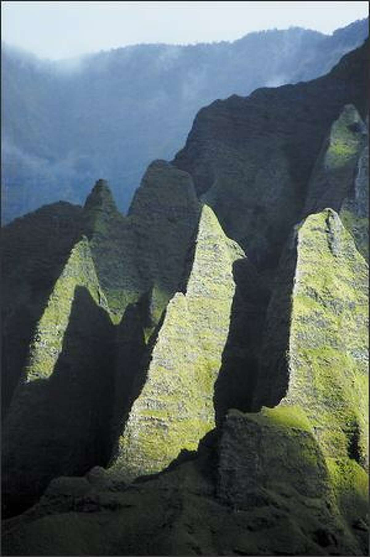 The morning sun kisses the otherworldly terrain of the Kalalau Valley along the Na Pali Coast.
