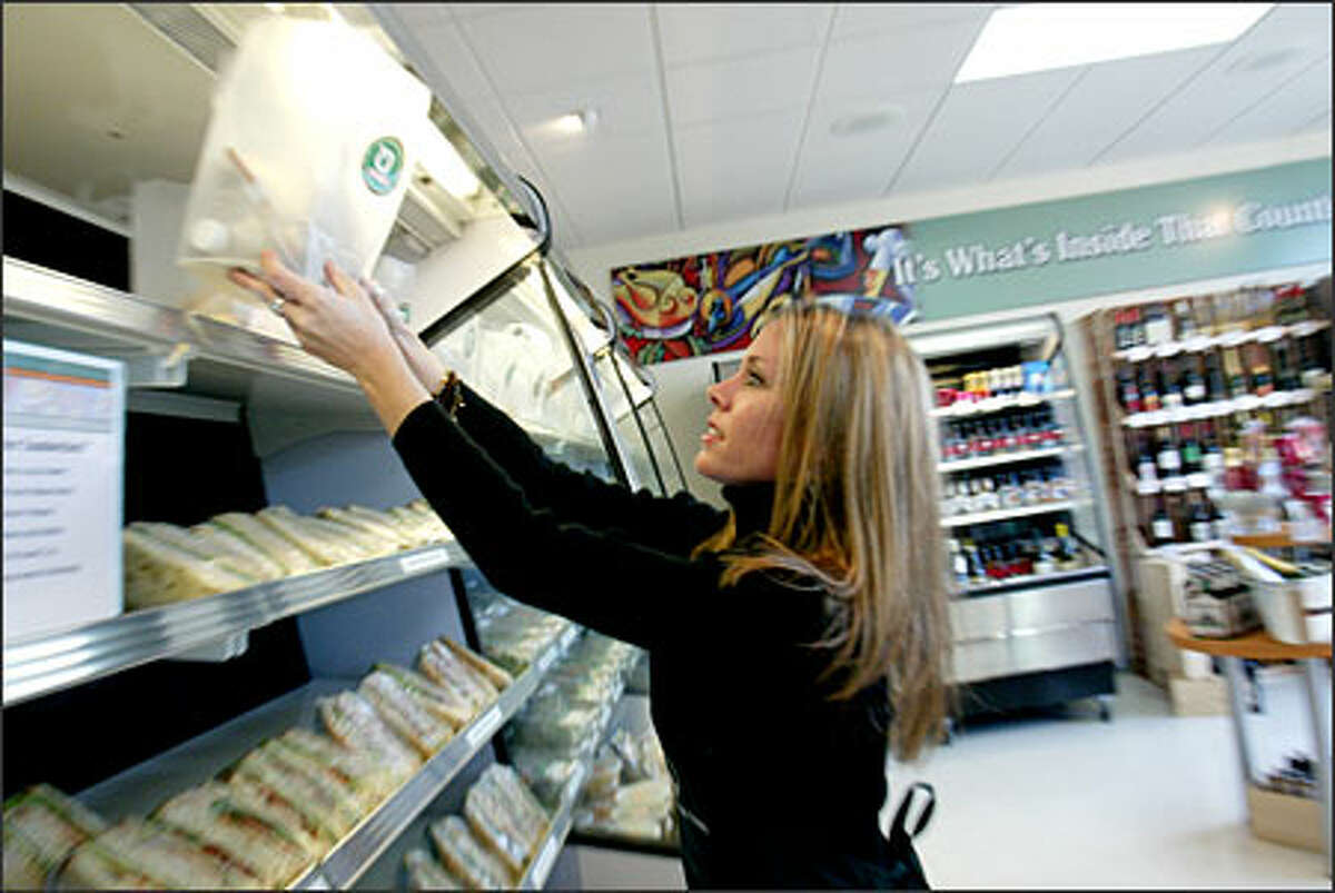 Kara Peters stocks lunches on the shelves at Organic To Go's Issaquah store, 5610 E. Lake Sammamish Parkway S.E. Order at 425-837-9922 or www.organictogo.com.