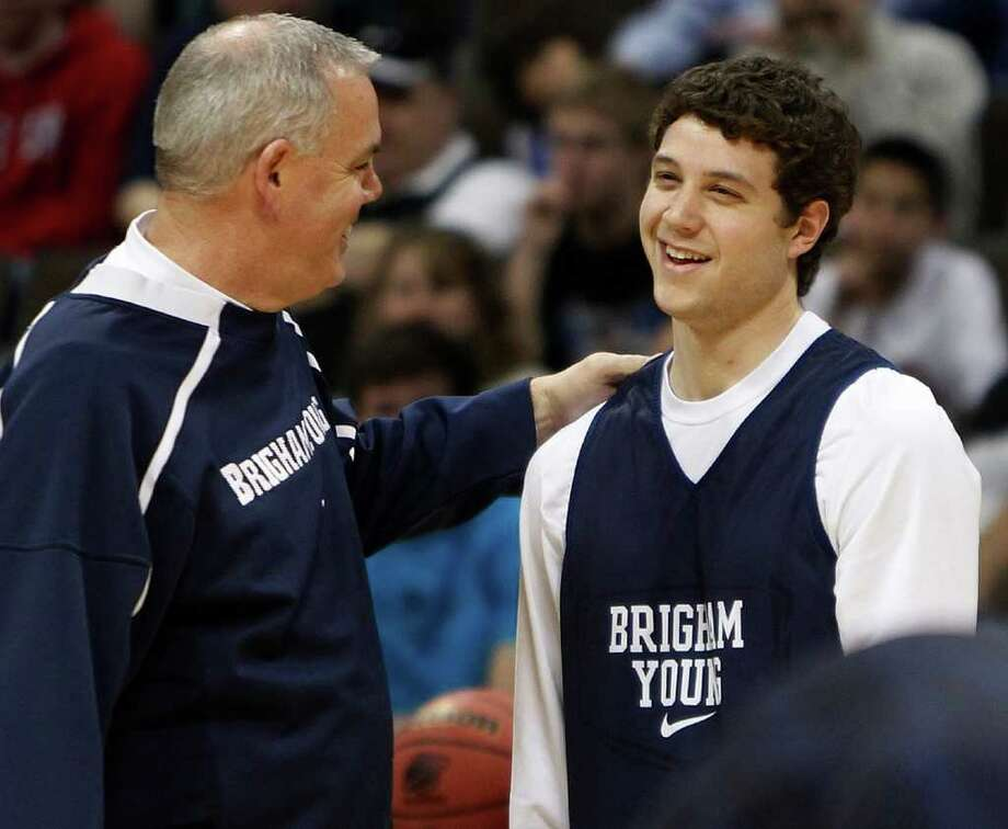 BYU coach Dave Rose talks to guard Jimmer Fredette during practice at the Pepsi Center in Denver on Wednesday, March 16, 2011, as BYU gets ready for an NCAA college basketball tournament second-round game against Wofford on Thursday. (AP Photo/ Ed Andrieski) Photo: Ed Andrieski