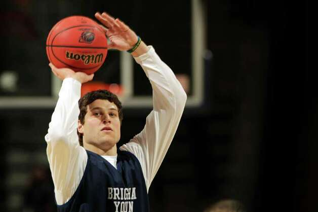 DENVER, CO - MARCH 16:  Jimmer Fredette #32 of the Brigham Young Cougars takes part in practice prior to their second round NCAA Men's Basketball Tournament game at the Pepsi Center on March 16, 2011 in Denver, Colorado.  (Photo by Doug Pensinger/Getty Images) Photo: Doug Pensinger