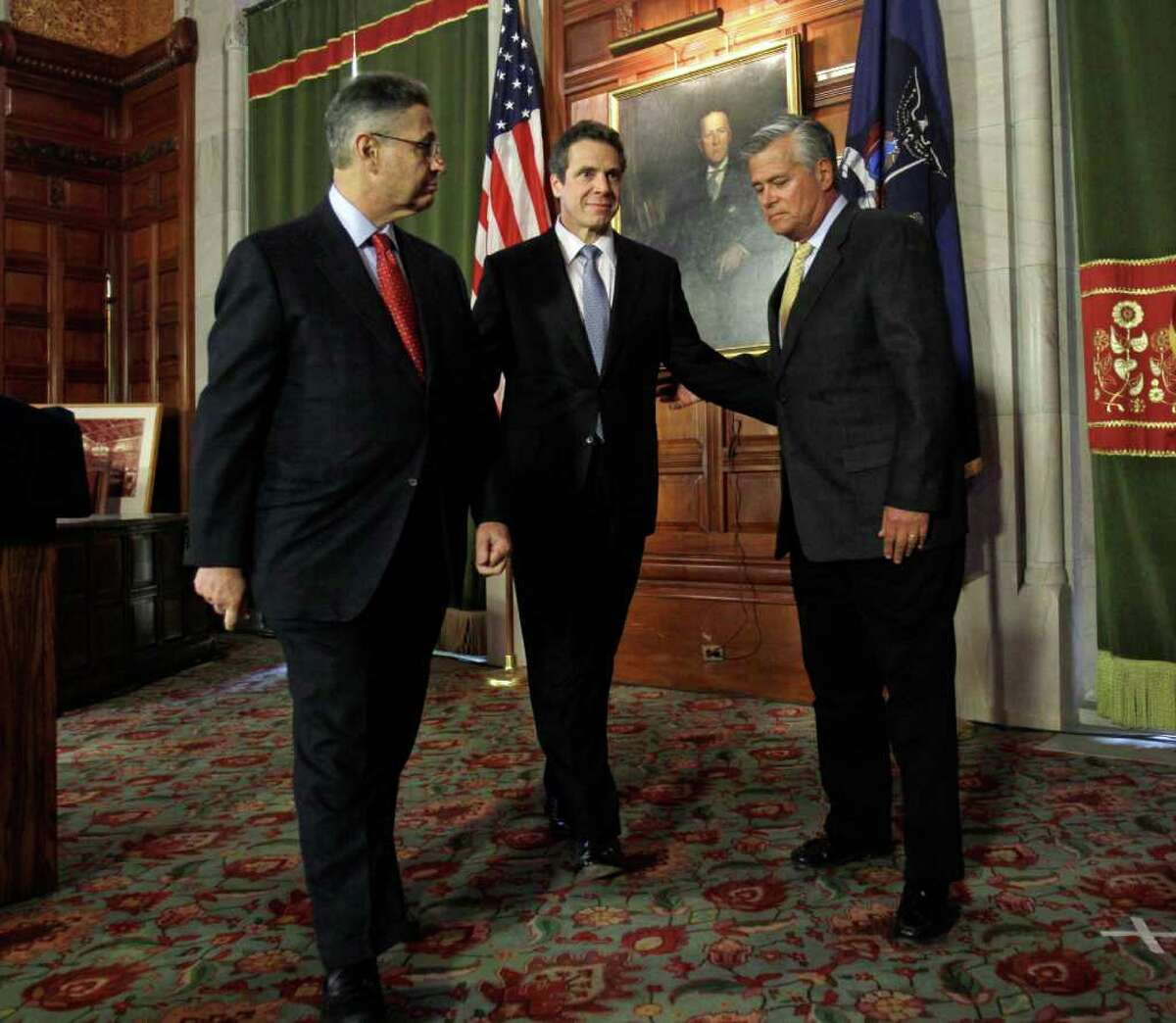 New York Gov. Andrew Cuomo, center, Assembly Speaker Sheldon Silver, D-Manhattan, left, and Senate Majority Leader Dean Skelos, R-Rockville Centre, leave a news conference in the Red Room at the Capitol in Albany, N.Y., Wednesday, March 16, 2011. (AP Photo)