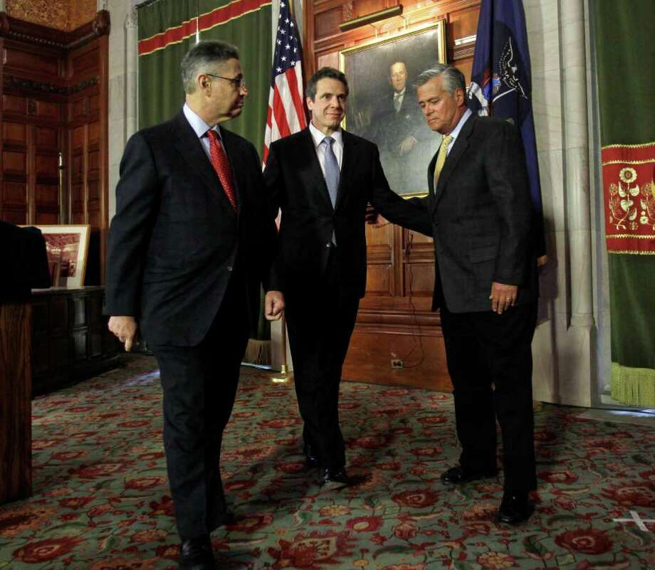 New York Gov. Andrew Cuomo, center, Assembly Speaker Sheldon Silver, D-Manhattan, left, and Senate Majority Leader Dean Skelos, R-Rockville Centre, leave a news conference in the Red Room at the Capitol in Albany, N.Y., Wednesday, March 16, 2011. (AP Photo) Photo: Mike Groll