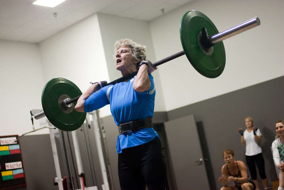 Jane Hemby, 61, lifts weights to get in shape for the Senior Games, which will take place from March 31 to April 10. Photo: Courtesy Photo/Kelley Ramotowski