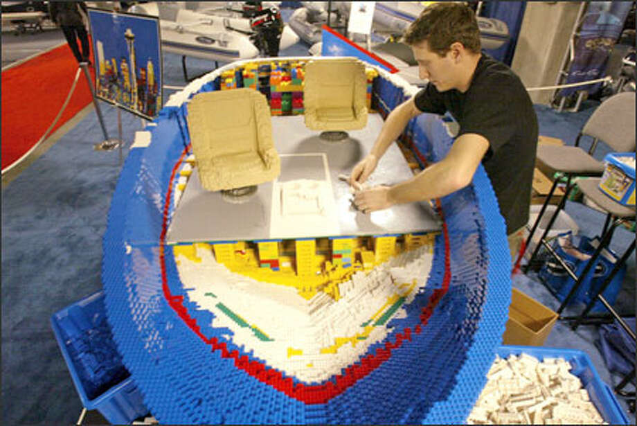 Nathan Sawaya has been putting in 14- to 18-hour days building his Chris-Craft replica at the Seattle Boat Show. Photo: Phil H. Webber/Seattle Post-Intelligencer