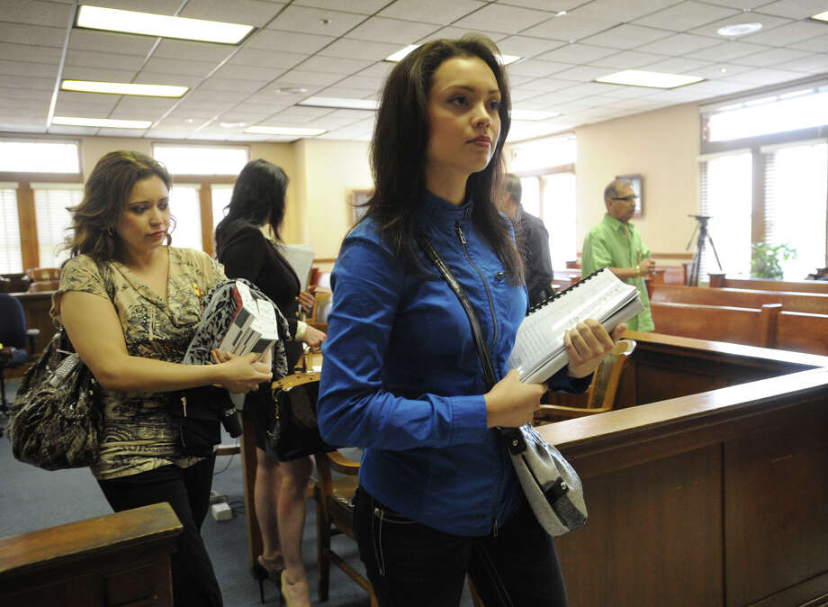 Former Miss San Antonio Domonique Ramirez leaves court after opening arguments in her lawsuit to regain her crown. Photo: BILLY CALZADA/gcalzada@express-news.net