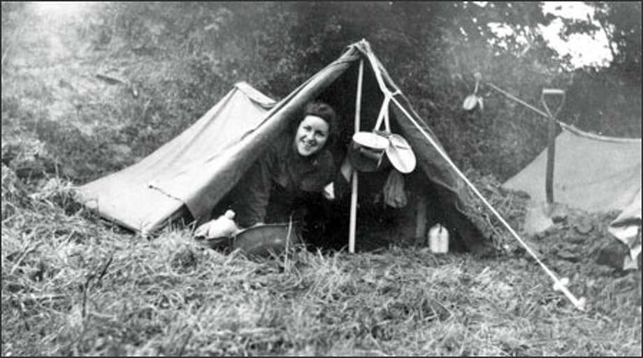 Rosalou Etue in a pup tent over a foxhole in Avranches, France, in July 1944. Etue was one of the few U.S. Army combat nurses to go to France, landing on the beach in Normandy. She survived capture by the Nazi SS. Photo: / Family Photo / FAMILY HANDOUT