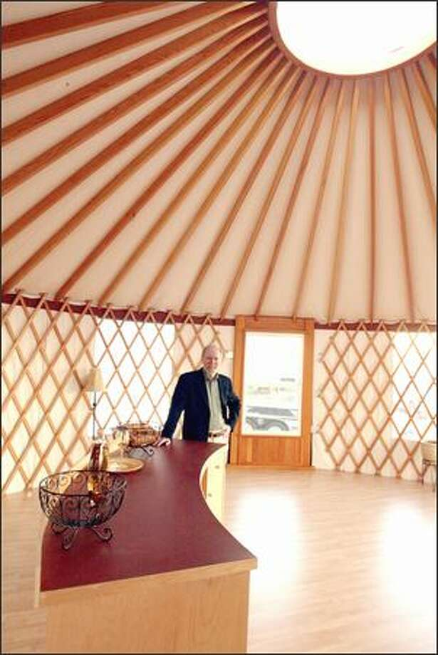 Rainier Industries President Scott Campbell stands inside of one of the Tukwila company's yurts. In one of four acquisitions last year, Rainier took over Nesting Bird Yurts and now makes the circular cloth-and-wood structures. Photo: PHIL H. WEBBER/P-I