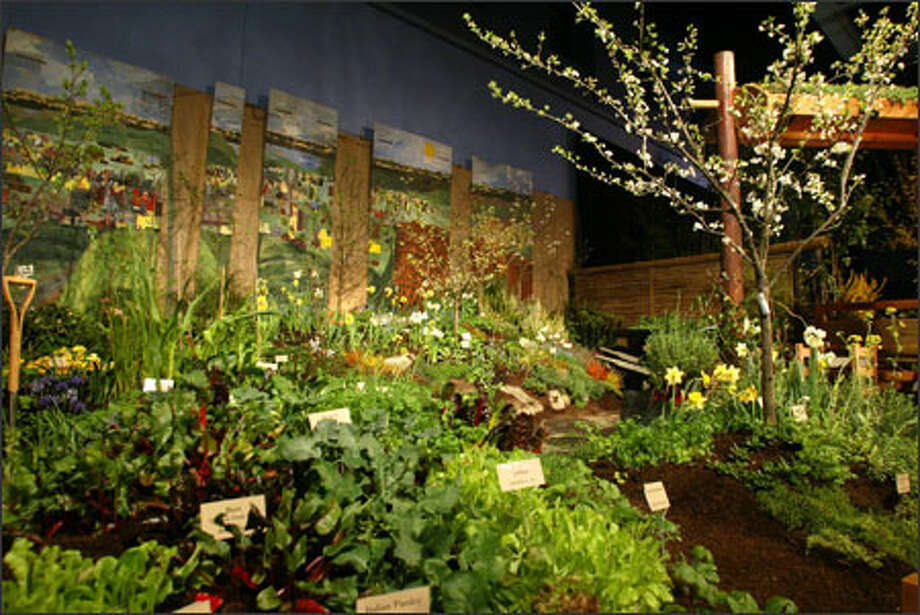 "The display garden created by Seattle Youth Garden Works -- ""Urban Land Use and Food Security"" -- won three top awards, including the Founder's Cup for the best overall display. Photo: Karen Ducey/Seattle Post-Intelligencer / Seattle P-I"