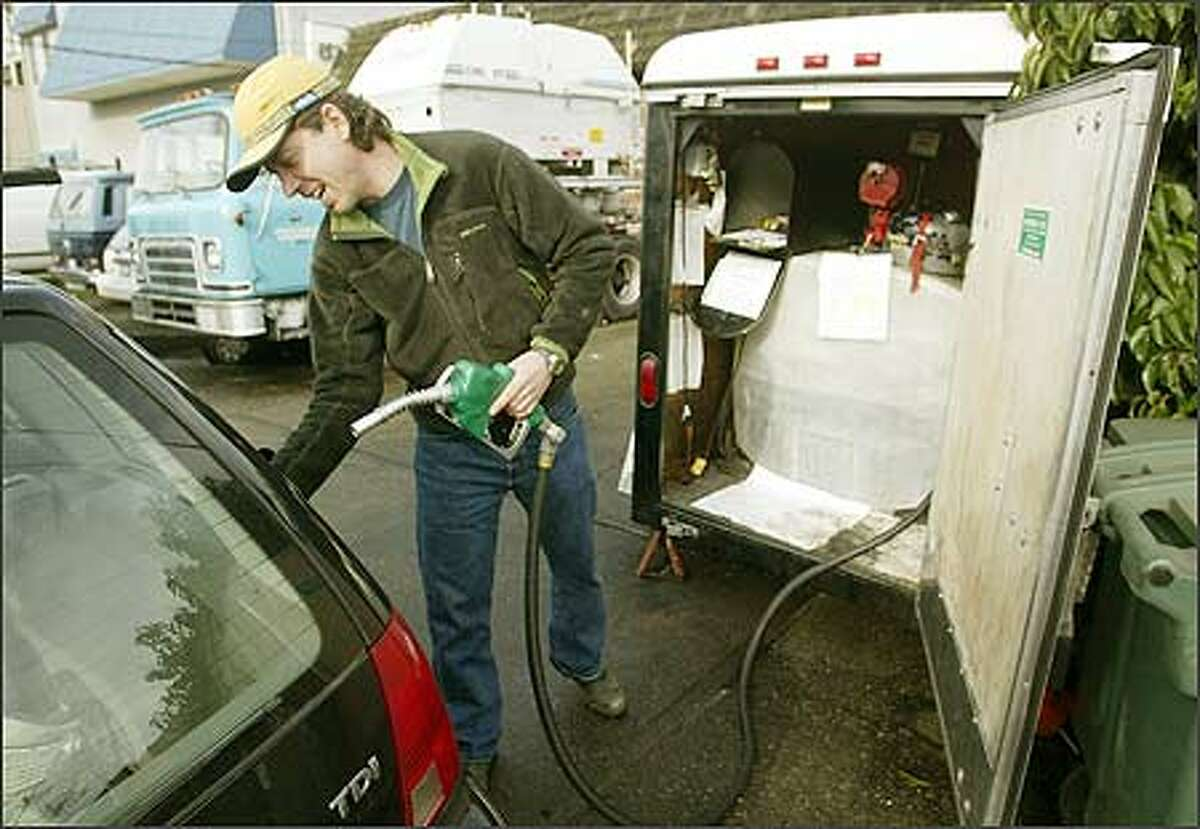 Andy McConnell prepares to fill his Volkswagen with biodiesel at Dr. Dan's Alternative Fuel Werks in Ballard.