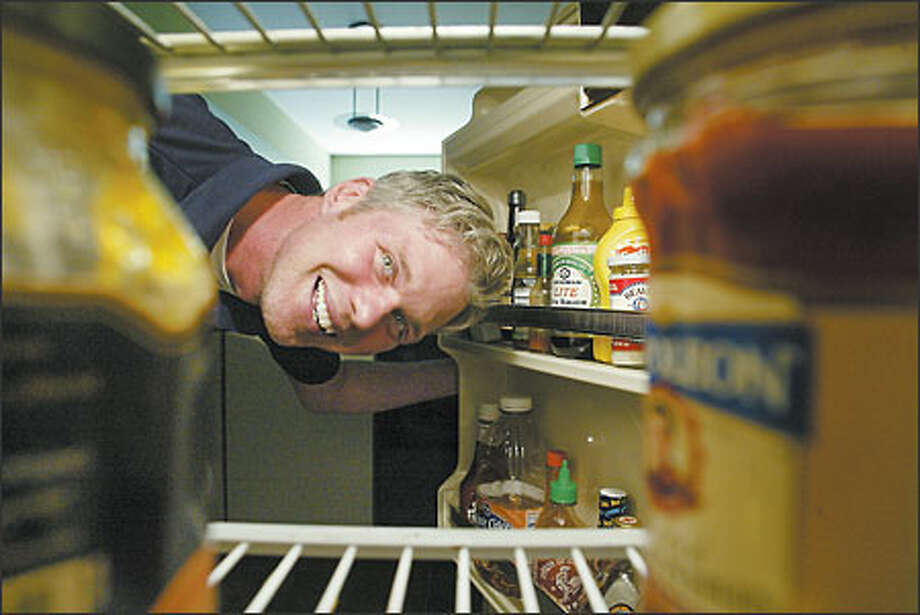 When Matt D'Angelo peers into his refrigerator, he keeps seeing the same bottles staring back at him. Chill out! Condiment help is near. Photo: Mike Urban/Seattle Post-Intelligencer