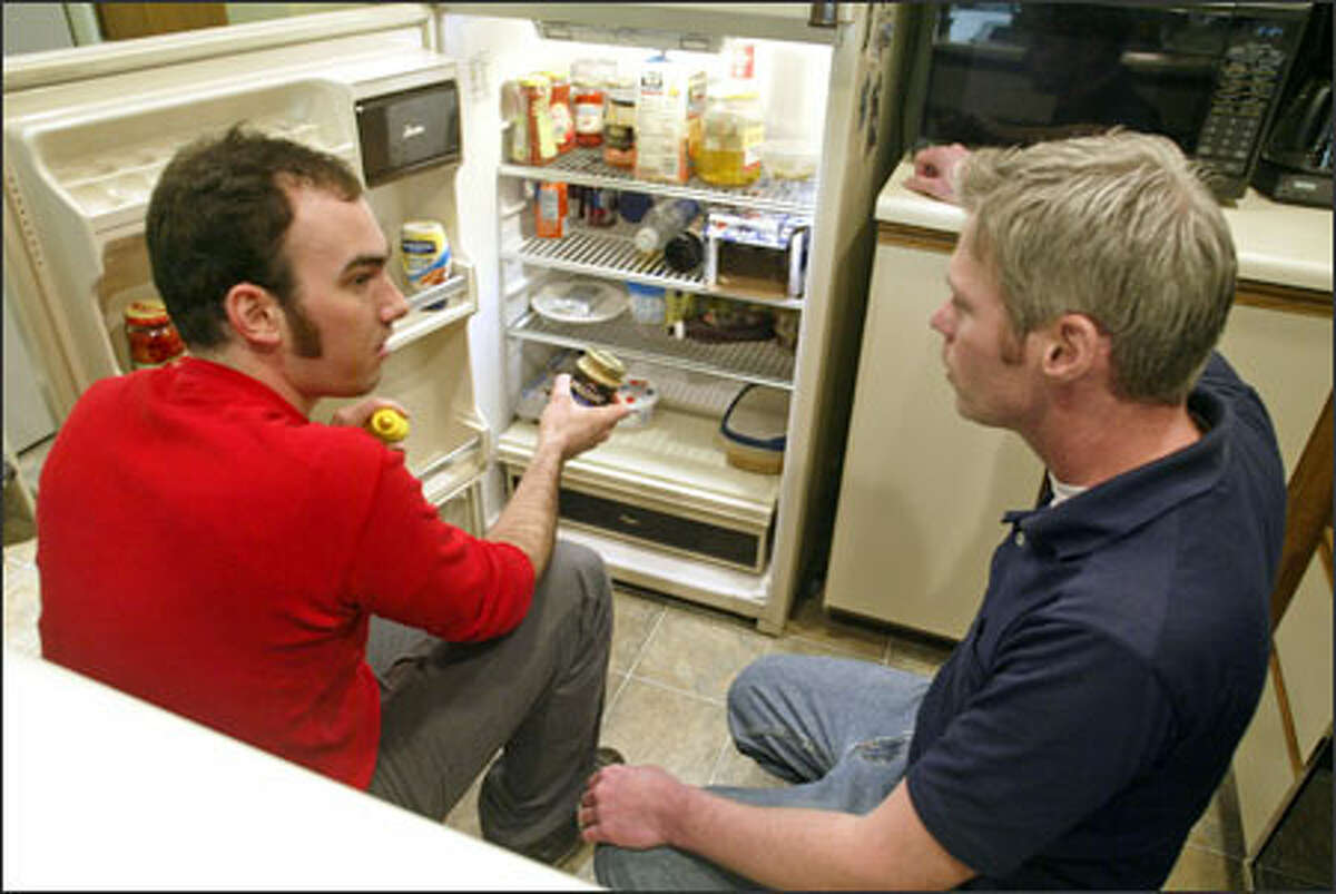 Chef Tyler Boring, left, gives Matt D'Angelo some tips for slimming down his fridge flab
