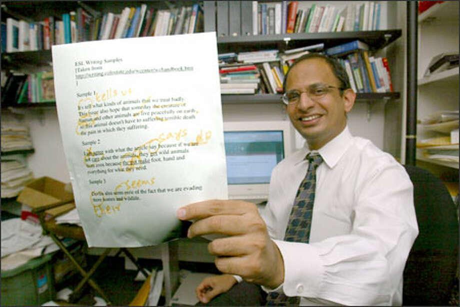 Sandeep Krishnamurthy shows a marked up example of how Microsoft's Word grammar checker doesn't quite do the job. Photo: Karen Ducey/Seattle Post-Intelligencer