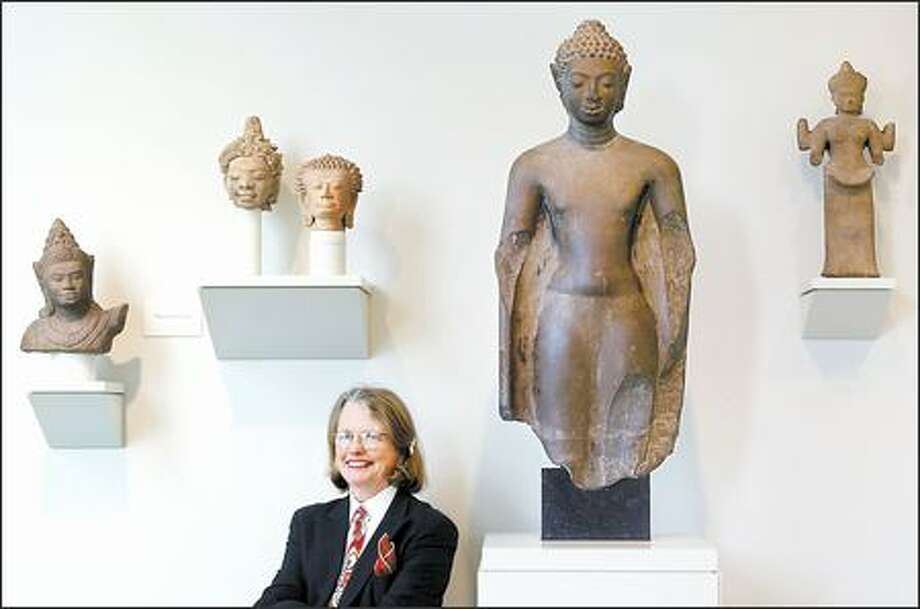 In her more than 10 years as director of the Seattle Art Museum, Mimi Gates, seen here at the Seattle Asian Art Museum, has persevered through change, massive growth and adversity. Photo: DAN DELONG/P-I