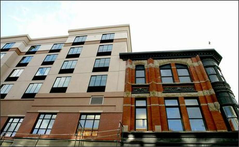The Greater Tacoma Convention & Trade Center's companion is the Marriott Courtyard, a styleless structure with its north end butting the fetching 1890 restored Waddell Building and its back facing Pacific Avenue, the city's historic spine. Photo: Meryl Schenker/Seattle Post-Intelligencer