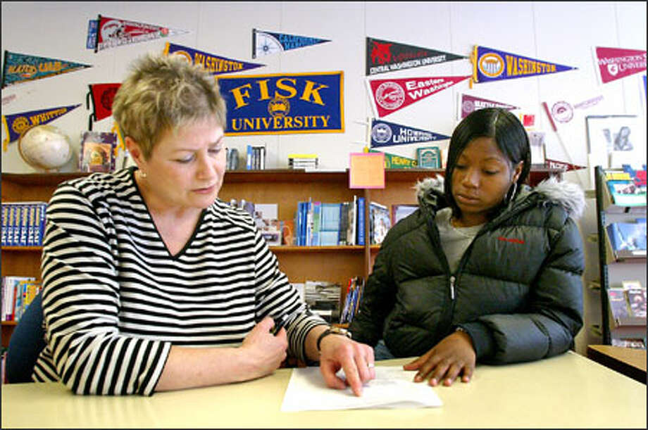 Career specialist Barbara Quintana works with Rainier Beach junior Leah Gant, who wants to study cosmetology. Quintana worries students won't get the help they need if her position is cut. Photo: Gilbert W. Arias/Seattle Post-Intelligencer / SEATTLE POST- INTELLIGENCER