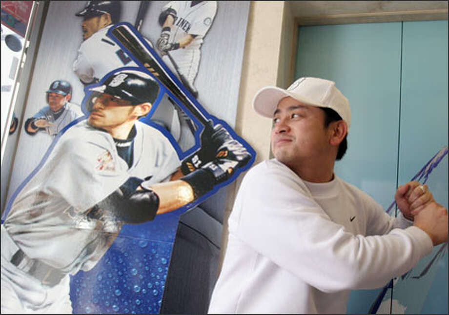 Atsushi Togo mimics the batting stance of Ichiro Suzuki at the entrance to a museum dedicated to the Mariner star near Nagoya, Japan. Photo: Noriyuki Aida/Special To The Seattle Post-Intelligencer