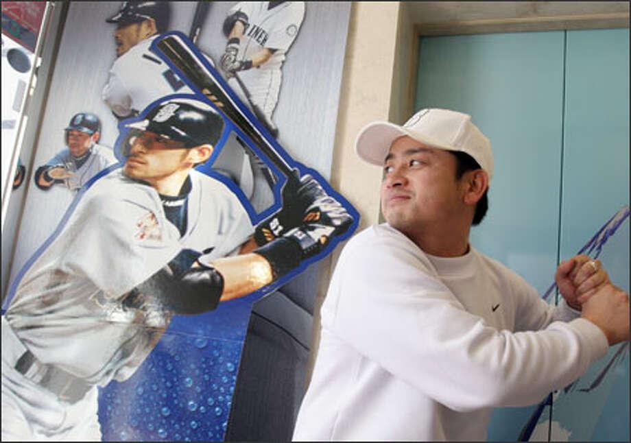 Atsushi Togo mimics the batting stance of Ichiro Suzuki at the entrance to a museum dedicated to the Mariner star near Nagoya, Japan. Photo: Noriyuki Aida/Special To The Seattle Post-Intelligencer