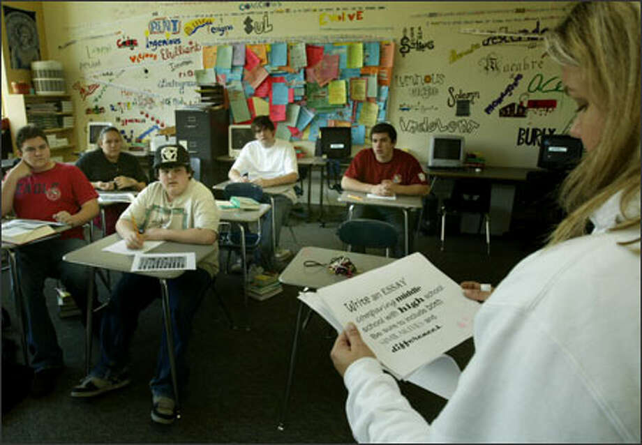 West Seattle High School language arts/humanities teacher Kim Zamoff reads a sample WASL question to sophomores, who start taking the test tomorrow. Photo: Grant M. Haller/Seattle Post-Intelligencer / Seattle Post-Intelligencer
