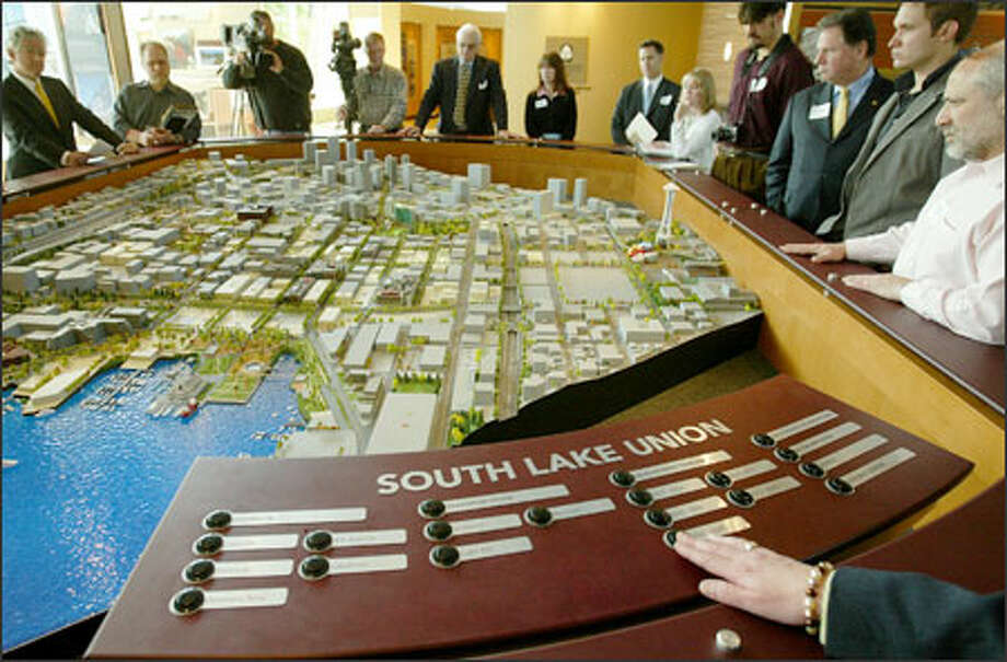 Ada M. Healey of Vulcan Real Estate demonstrates an interactive model of the Paul Allen-owned company's plans for South Lake Union yesterday. Photo: Paul Joseph Brown/Seattle Post-Intelligencer