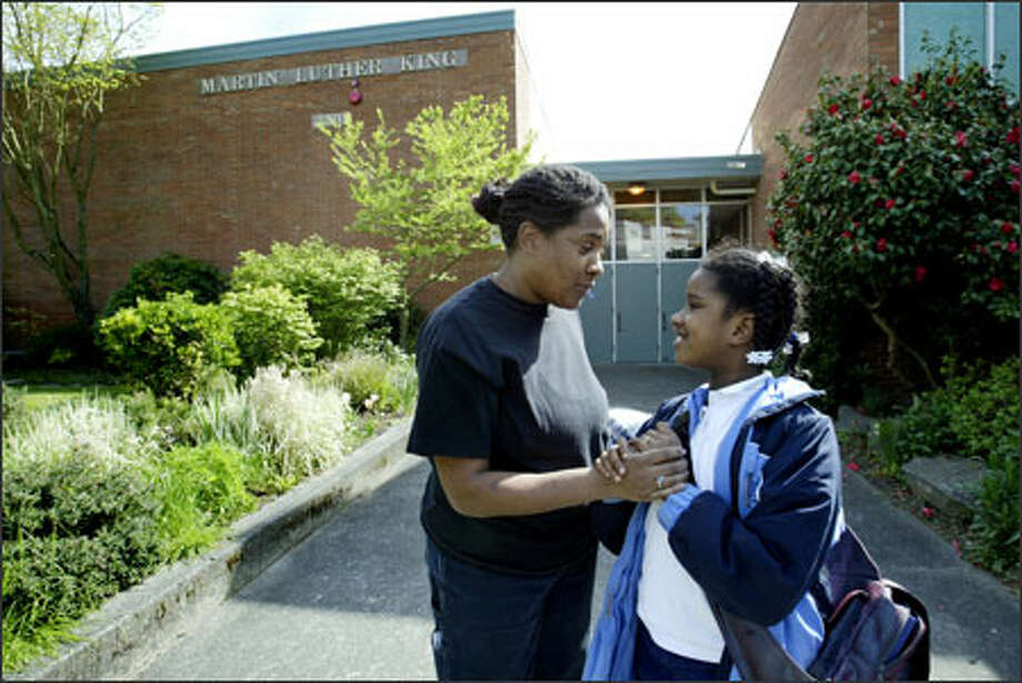 Tanya Beverly talks with her daughter Mariah, a third-grader, after a day of school at Martin Luther King Elementary School in Madison Valley. Photo: Dan DeLong/Seattle Post-Intelligencer