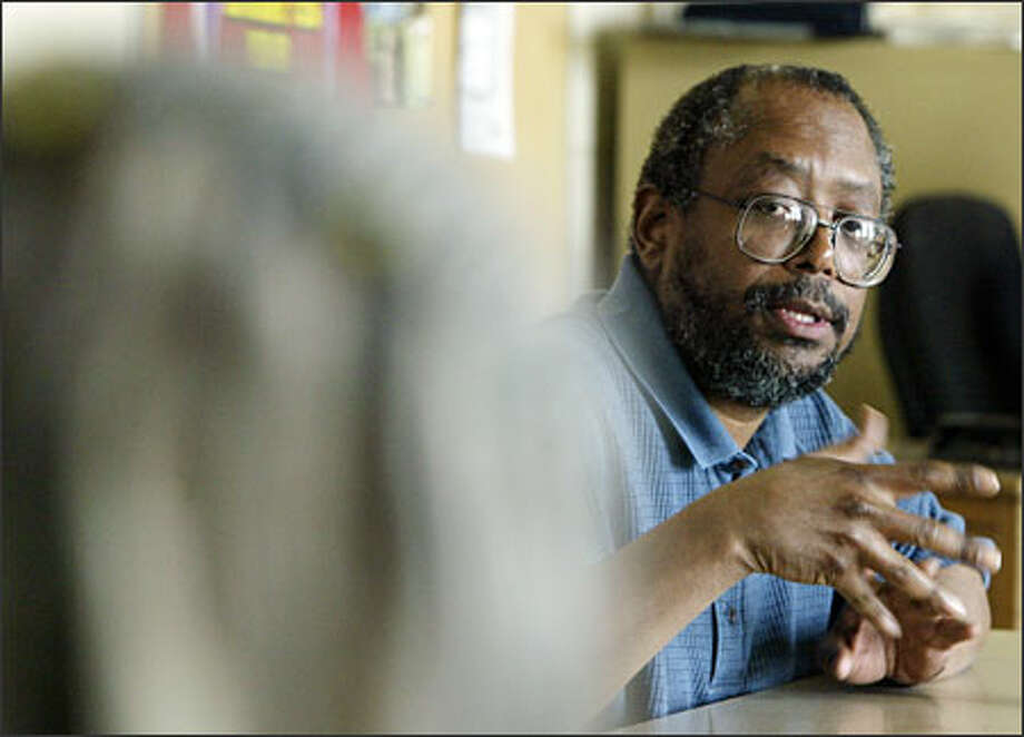 "Edward P. Jones won the 2004 Pulitzer Prize in fiction for ""The Known World,"" inspired by Jones' discovery that some blacks before the Civil War owned slaves. He met with Garfield High students as part of the Writers in the Schools program run by Seattle Arts & Lectures. Photo: Grant M. Haller/Seattle Post-Intelligencer"