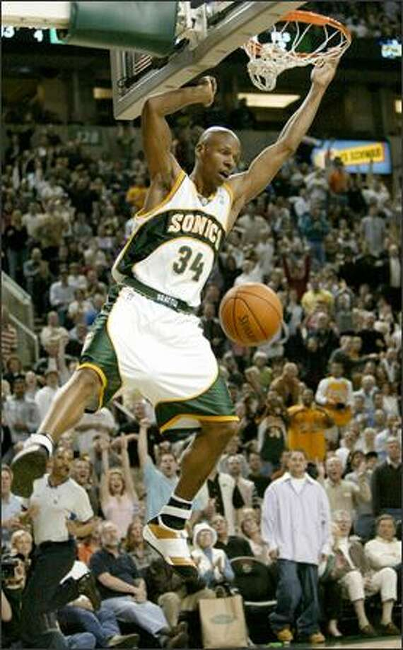 Seattle's Ray Allen has a breakaway dunk in the second quarter of Game 1 of the NBA Western Conference quarterfinals against Sacramento at KeyArena. See a full gallery of game photos. Photo: Dan DeLong/Seattle Post-Intelligencer