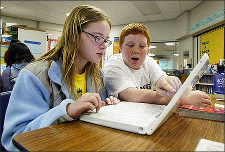 Echo Lake Elementary sixth-graders Katie Wachholz, 11, and Taylor Winsor, 11, use their laptop to search the Internet for information about the Great Wall of China. Photo: Gilbert W. Arias/Seattle Post-Intelligencer