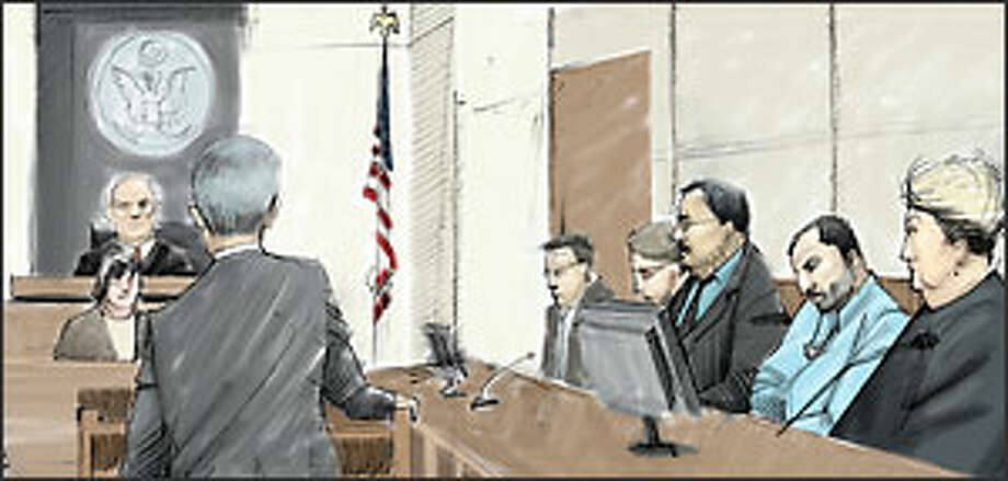 Ahmed Ressam sits between attorney  Jo Ann Oliver (far right) and his Arabic interpreter as prosecutor Mark Bartlett speaks before U.S. District Judge John Coughenour. Photo: David Badders/P-I