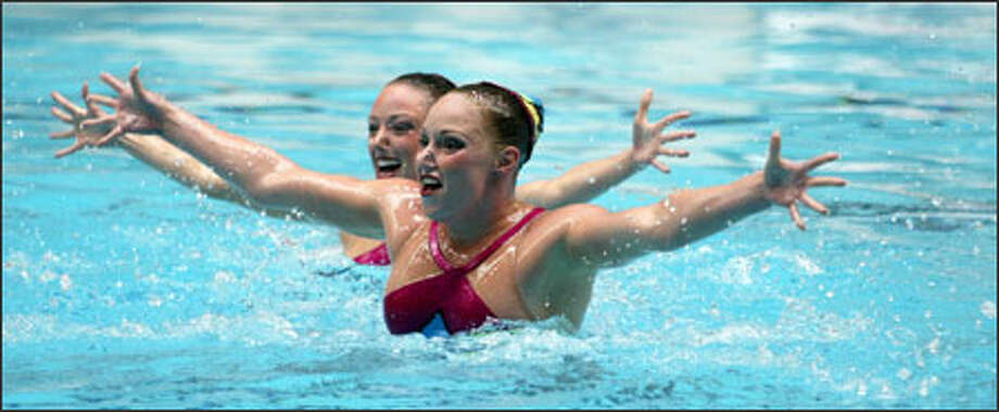 Olympic veterans Courtenay Stewart, rear, and Sara Lowe from Stanford perform their duet technical routine at the U.S. National Synchronized Swimming Championships in Federal Way. Photo: Meryl Schenker/Seattle Post-Intelligencer
