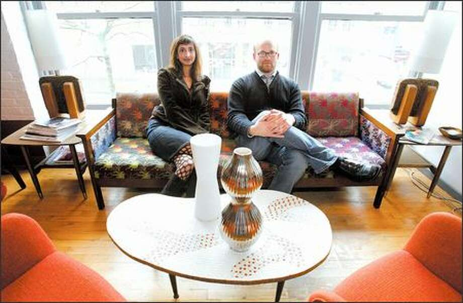 The Capitol Hill office of Rebecca Luke and Sean Schmidt, co-founders of Sustainable Style Foundation, is mostly decorated in thrift-store finds. On the table in the foreground are two of the Outstanding Sustainable Style Achievement Awards they were giving out. Photo: PAUL JOSEPH BROWN/P-I