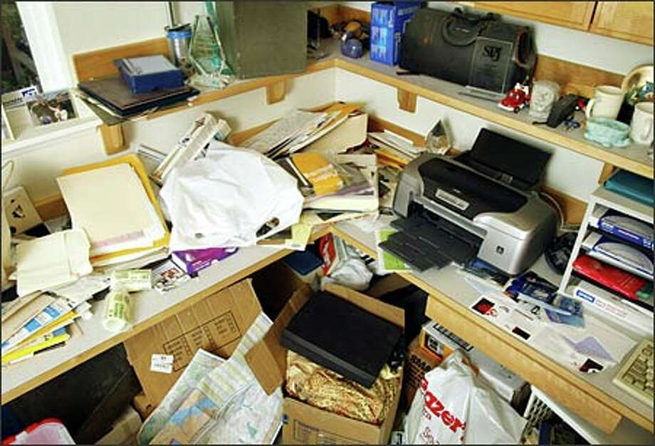 The office was in chaos before Jessica Duquette arrived on the scene. She suggested a new filing setup, and a paid helper to get it done. Photo: Joshua Trujillo/Seattle Post-Intelligencer