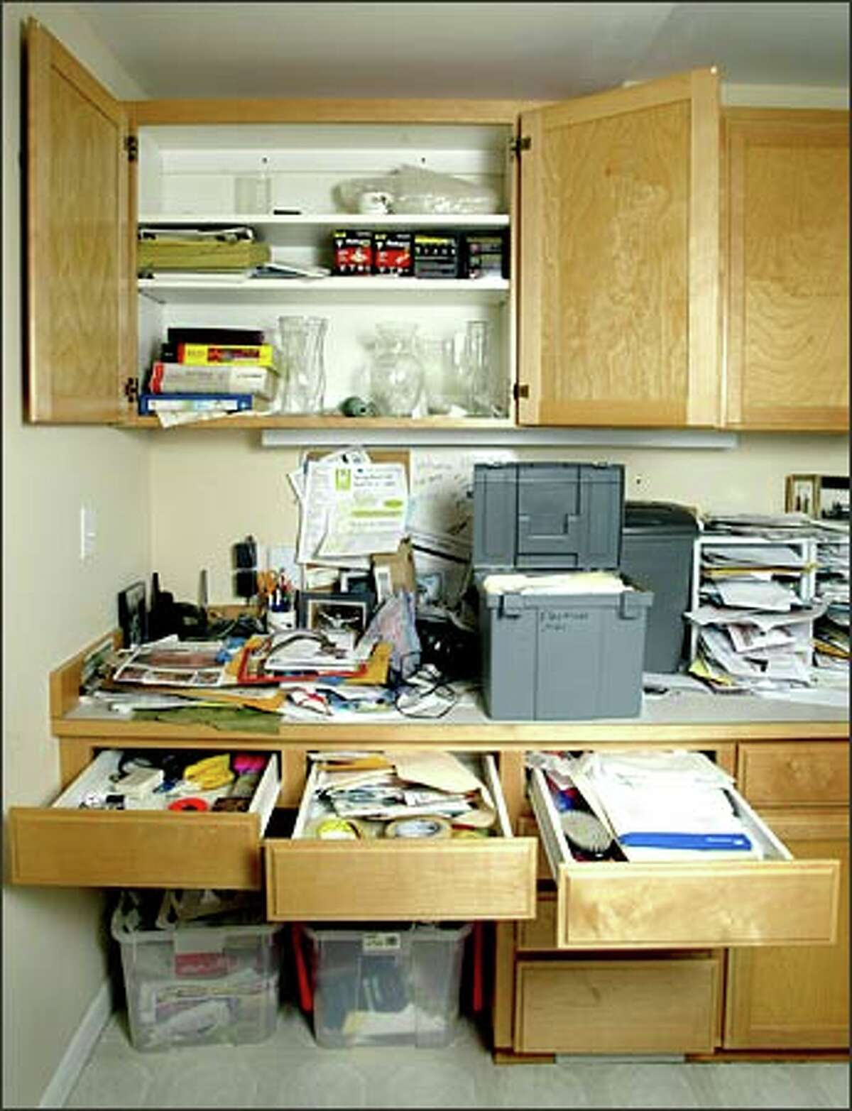 Counters, drawers and cabinets are stuffed in P-I reporter Rebekah Denn's kitchen office, crying out for a good de-cluttering.