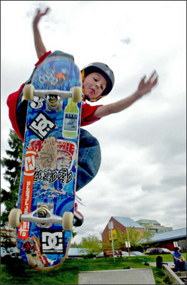 Mitchie Brusco, 8, practices his moves at the skateboard park in Kirkland. The first-grader, who's been skateboarding since he was 3, already has racked up sponsorships and media appearances. He says he doesn't know what drew him to skateboarding. Photo: Karen Ducey/Seattle Post-Intelligencer