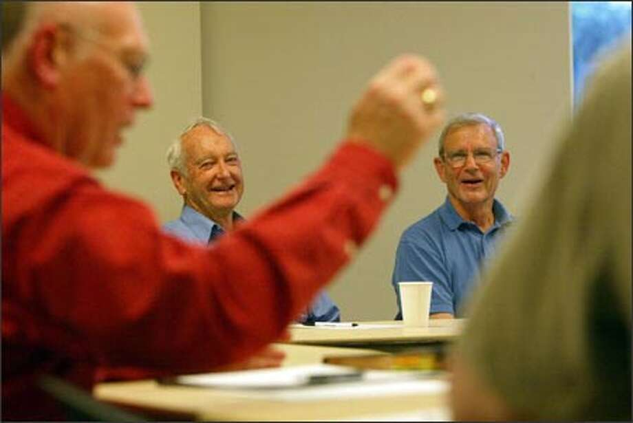 Wayne Bath, center, and John Garner, right, laugh at Jack Stevenson's joke during a monthly prostate cancer support group meeting yesterday in Bellevue. Photo: Grant M. Haller/Seattle Post-Intelligencer / Seattle Post-Intelligencer