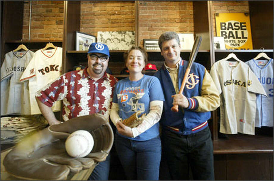 Ebbets Field Flannels store manager Steven Bird, left, and co-owners Lisa Cooper and Jerry Cohen inside display some goods at the shop in Seattle. Photo: Dan DeLong/Seattle Post-Intelligencer