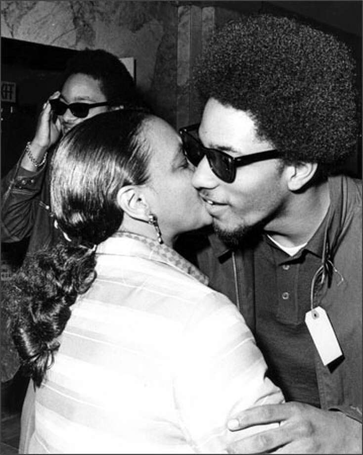 In this April 5, 1968, photo, Aaron Dixon, right, embraces his mother, Frances Dixon, after being released from jail in Seattle on charges of unlawful assembly. The charges were later dropped. Photo: /Seattle Post-Intelligencer