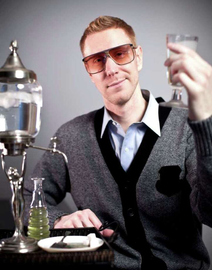 "Chris Buddy, director of the documentary ""Absinthe,"" displays a traditional set up used in the absinthe drinking ritual — glass, spoon, sugar cube, fountain and, of course, absinthe. Photo: Geoff Martin Photography, Geoff Martin Photography/Contributed Photo / Greenwich Citizen"