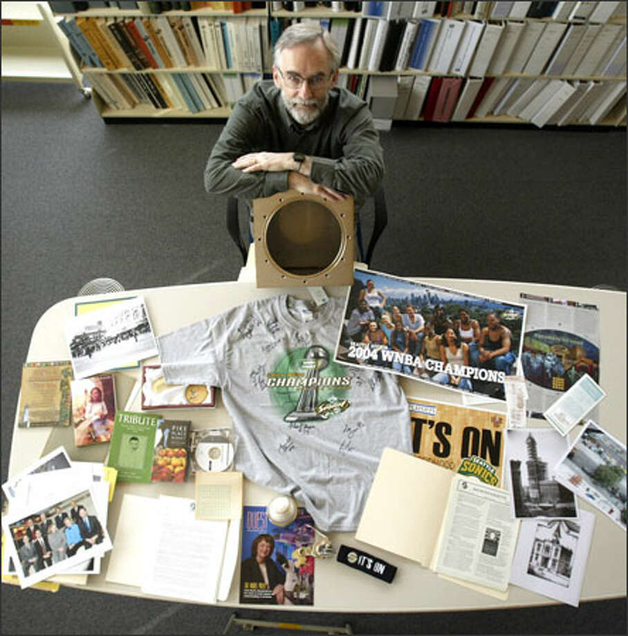 City Archivist Scott Cline has gathered Seattle memorabilia to be sealed in a stainless steel time capsule and buried under the new City Hall plaza today. Photo: Mike Urban/Seattle Post-Intelligencer